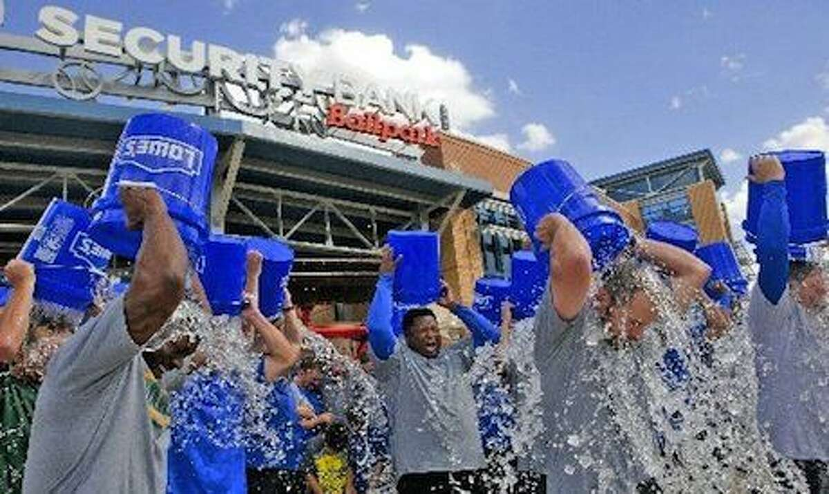 A group of RockHounds team and office staff as well as two Midland police officers and a city councilman participate in the ice bucket challenge to raise awareness for amyotrophic lateral sclerosis (ALS), also known as Lou Gehrig's disease on Wednesday at Security Bank Ballpark.James Durbin/Reporter-Telegram