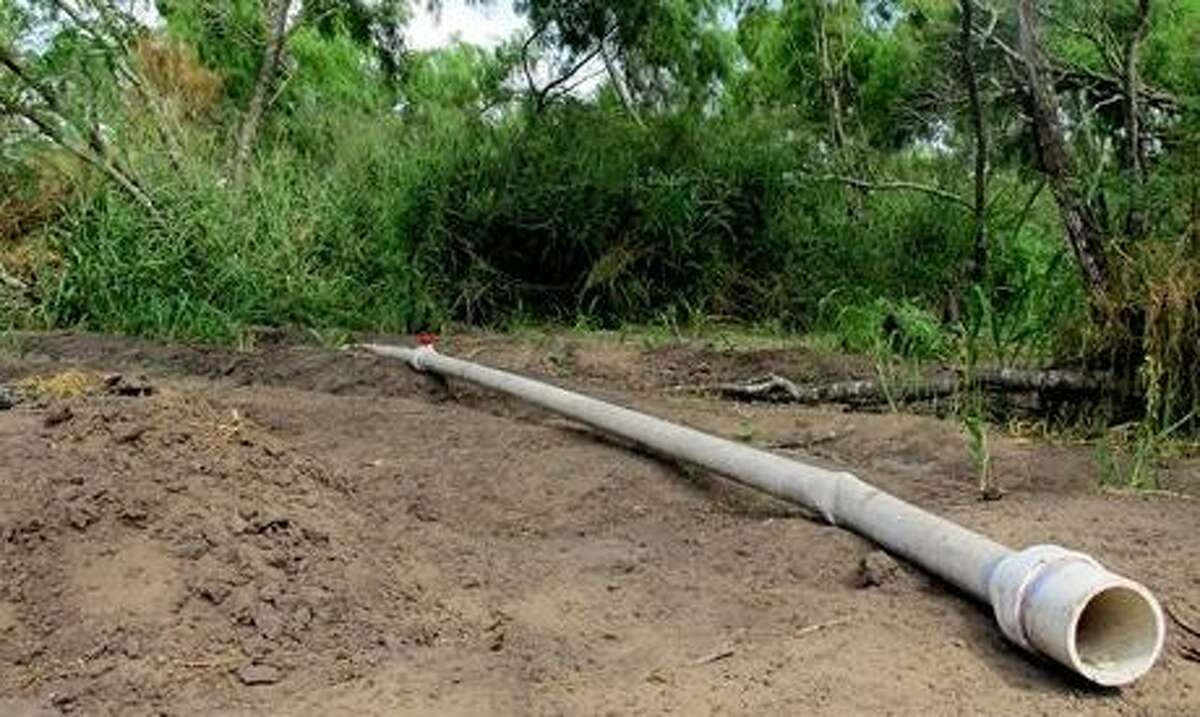 A section of pipe that was used to irrigate a two-acre marijuana farm is hidden in the brush near Raymondville, Texas on Thursday, Aug. 22, 2014. Authorities found the operation, which is rare so close to the border, while attempting to capture immigrants who fled into it on Aug. 13. Associated Press/Christopher Sherman