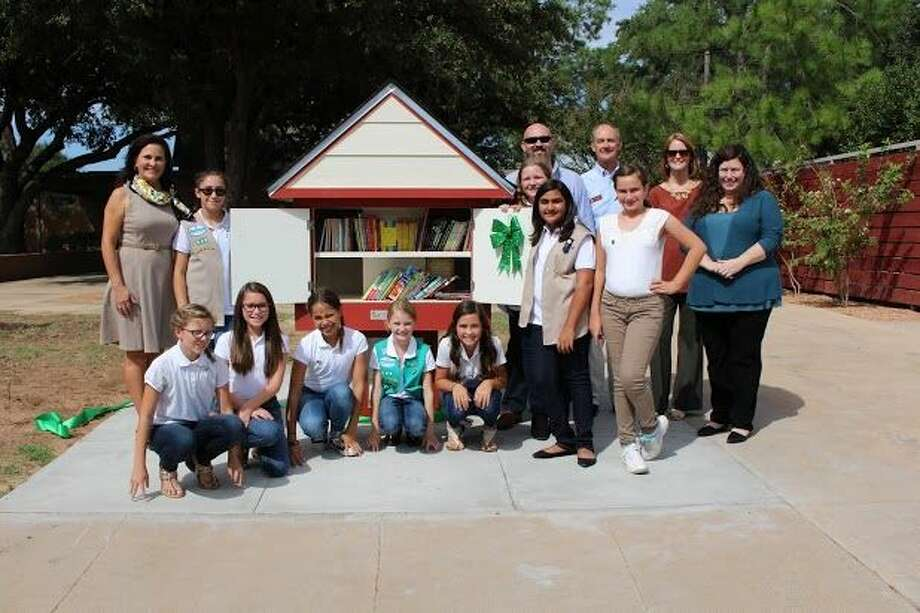 On Oct. 15, Trinity School Girl Scout Troop 46 held a ribbon cutting, debuting the first ever Little Free Library in Midland. Photo: Trent Johnson | Midland Reporter-Telegram