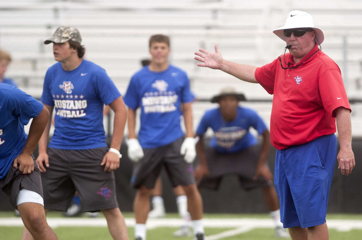 Midland Christian football coach Greg McClendon works with his team during practice Friday. James Durbin/Reporter-Telegram
