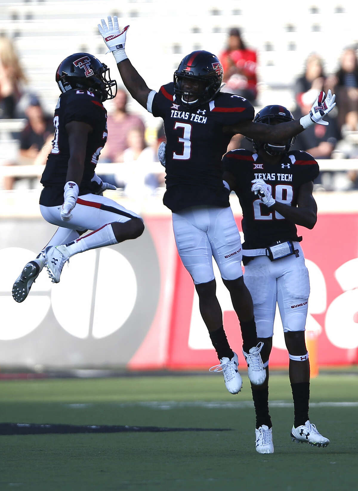 Texas Tech's Tevin Madison (20), J. J. Gaines (3) and Paul Banks III (28) jump on the field against Iowa State, Saturday, Oct. 10, 2015, in Lubbock. Texas Tech won 66-31. (Allison Terry/Lubbock Avalanche-Journal via AP)