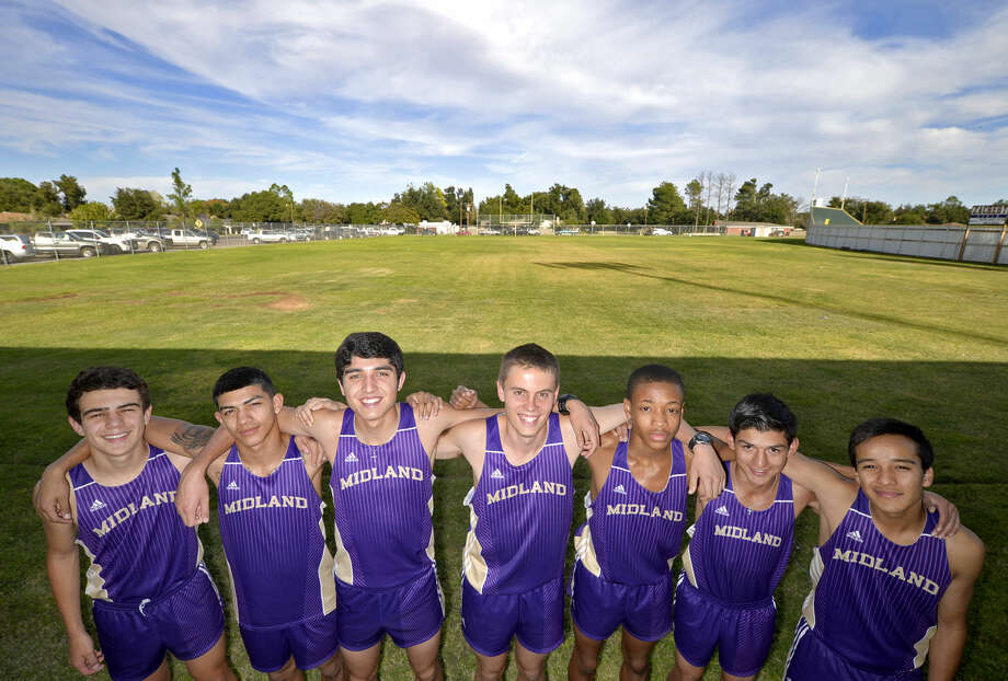 Midland High cross country team from left, Cade Michael, Michael Dutchover, Bryce Hoppel, Chad Schmidt, Jaylen Tryon, Lorenzo Mendez, and Ruben Guerra in portrait Thursday, Oct. 15, 2015 at Memorial Stadium. James Durbin/Reporter-Telegram Photo: James Durbin