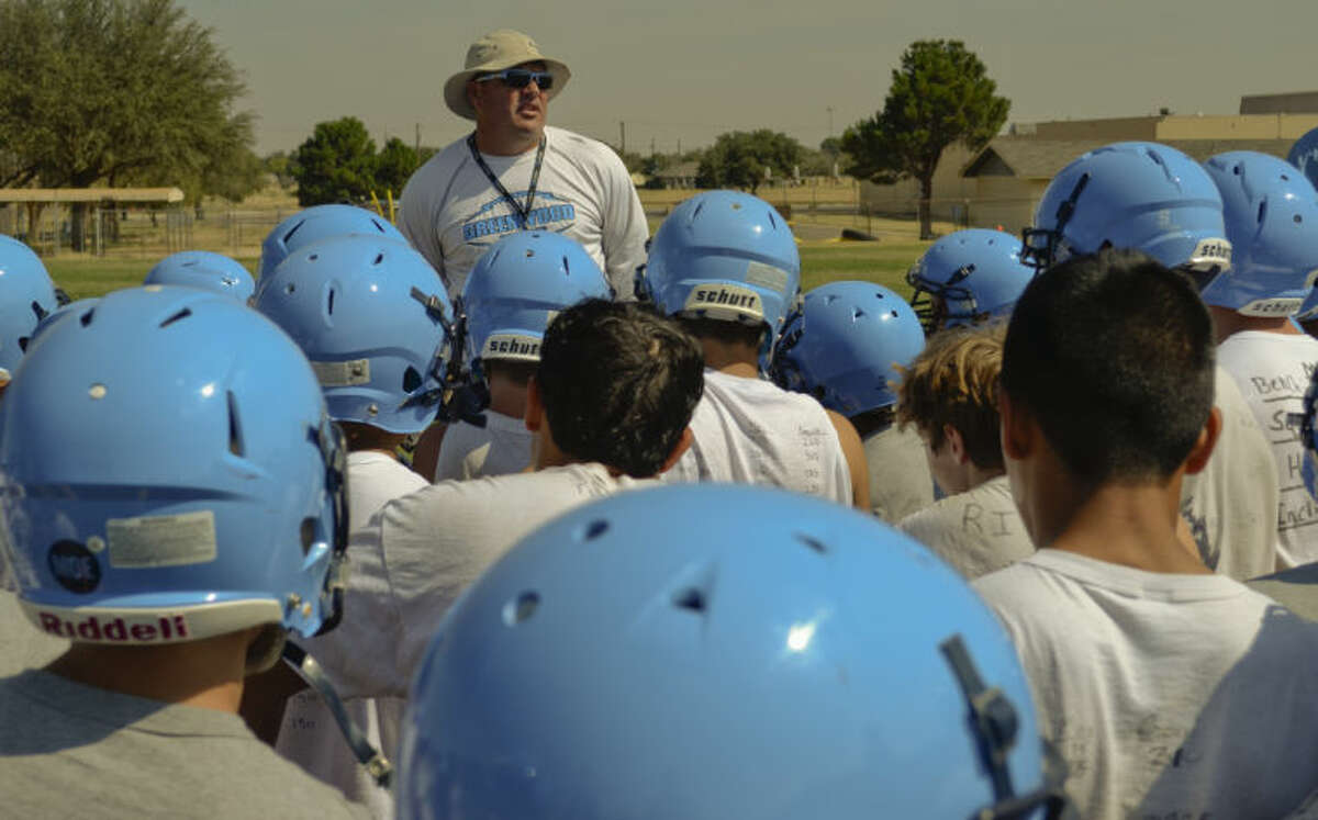 Greenwood coach Shad Hanna talks with his players during a break in fall camp. Tim Fischer\Reporter-Telegram