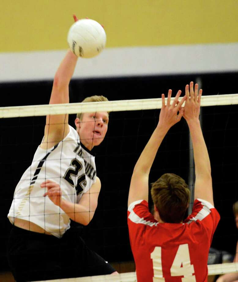 Trumbull's Justyn Schueler spikes the ball during boys volleybal action against Greenwich in Trumbull, Conn. on Friday May 6, 2016. Trumbull defeated Greenwich three sets to two. Photo: Christian Abraham / Hearst Connecticut Media / Connecticut Post