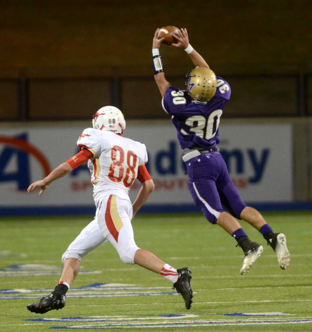 Midland High's Britt Boler makes an interception against Lubbock Coronado on Friday at Grande Communications Stadium. James Durbin/Reporter-Telegram