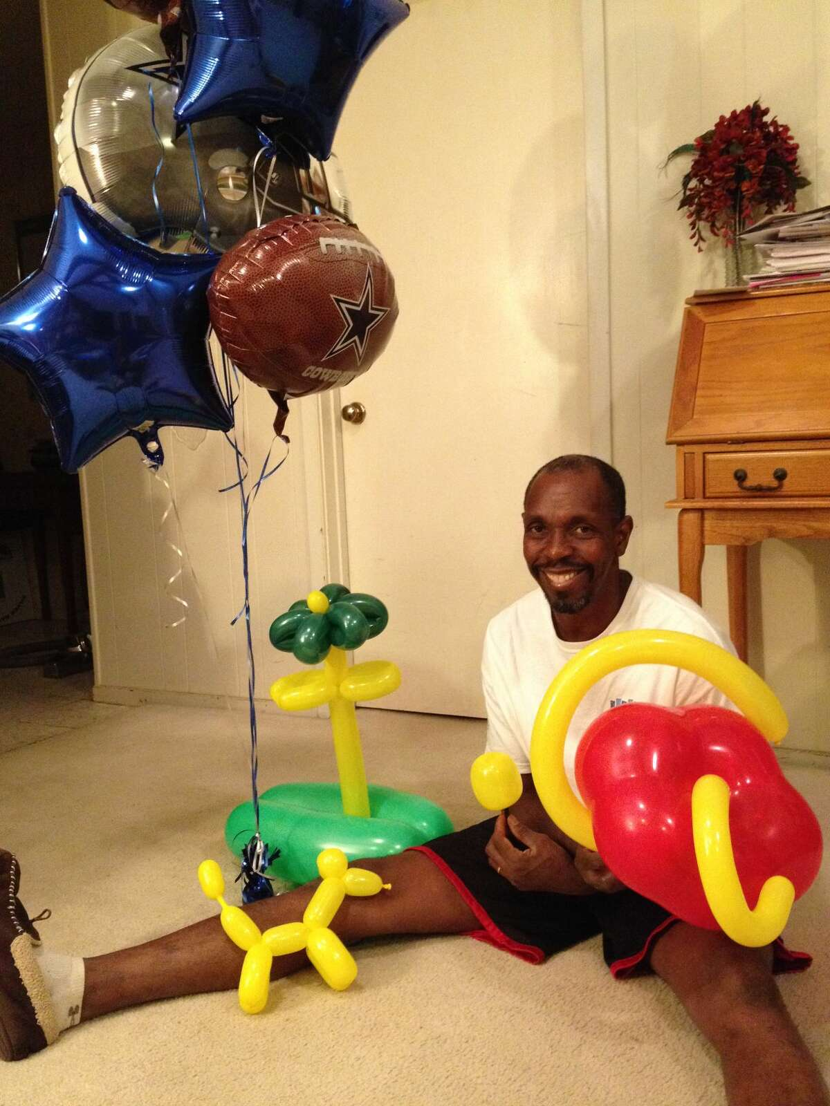 Retired teacher Larry Pitts shows of some of his handiwork. Pitts recently purchased Johnny's Balloons and More and is learning the ropes of creating balloon bouquets. Photo courtesy of Larry Pitts