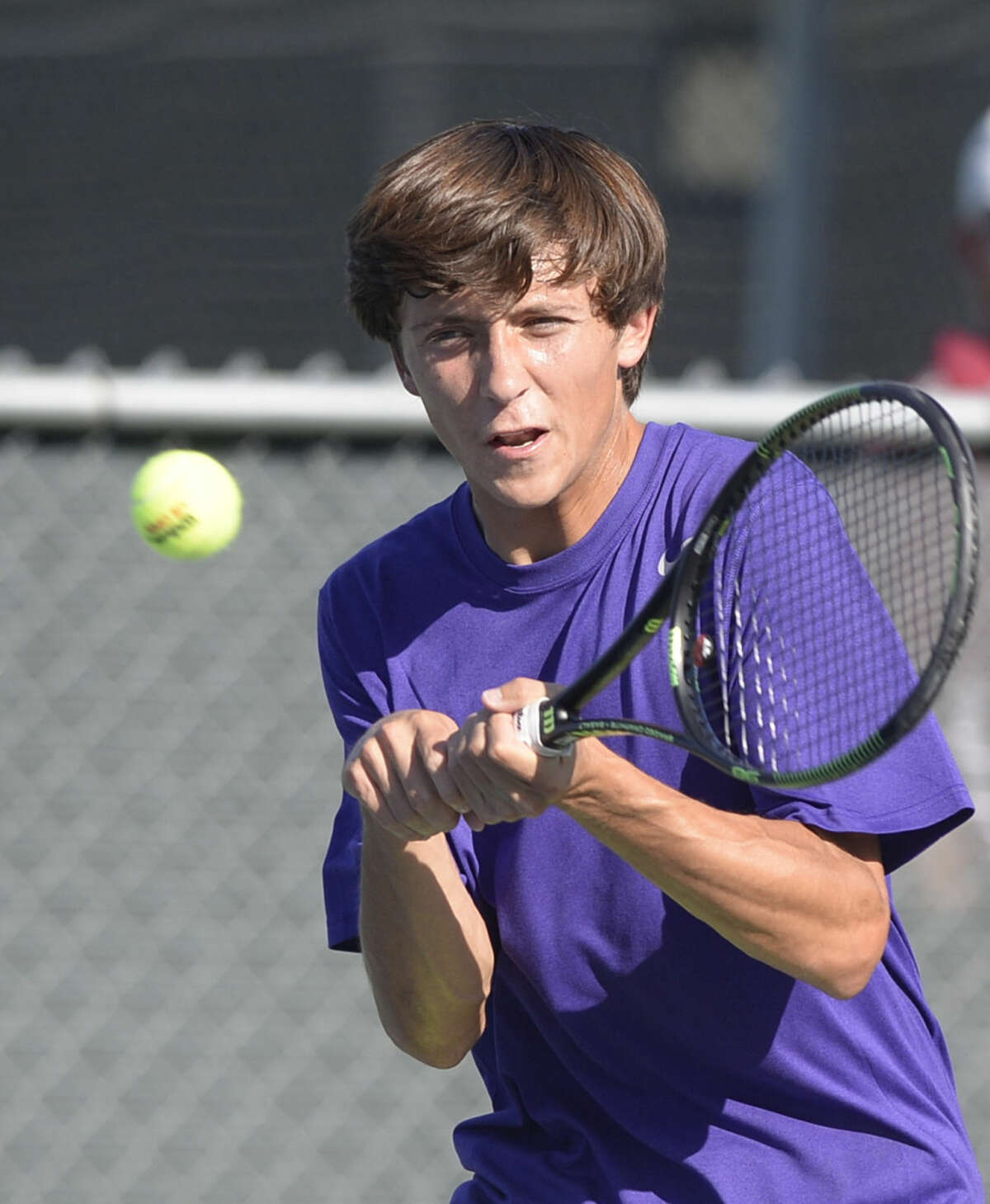 Midland High's Brandt Schneider competes in a doubles match with teammate Hayden Boldrick (not pictured) against Lee High on Tuesday, Oct. 6, 2015, at the Raquet Club. James Durbin/Reporter-Telegram