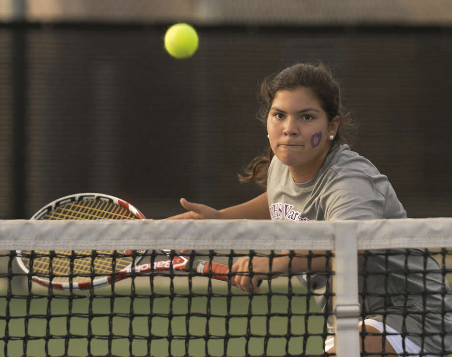 Sophia Salcedo returns a shot at the net Tuesday 10-20-2015 as she and doubles partnerEllie Hord play at the District 3-6A/4-6A Tournament. Tim Fischer\Reporter-Telegram Photo: Tim Fischer