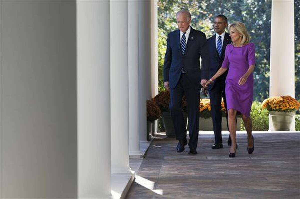Vice President Joe Biden, with his wife Dr. Jill Biden, and President Barack Obama walks toward the Rose Garden of the White House in Washington, Wednesday, Oct. 21, 2015, to announce that Biden will not run for the presidential nomination. (AP Photo/Jacquelyn Martin)