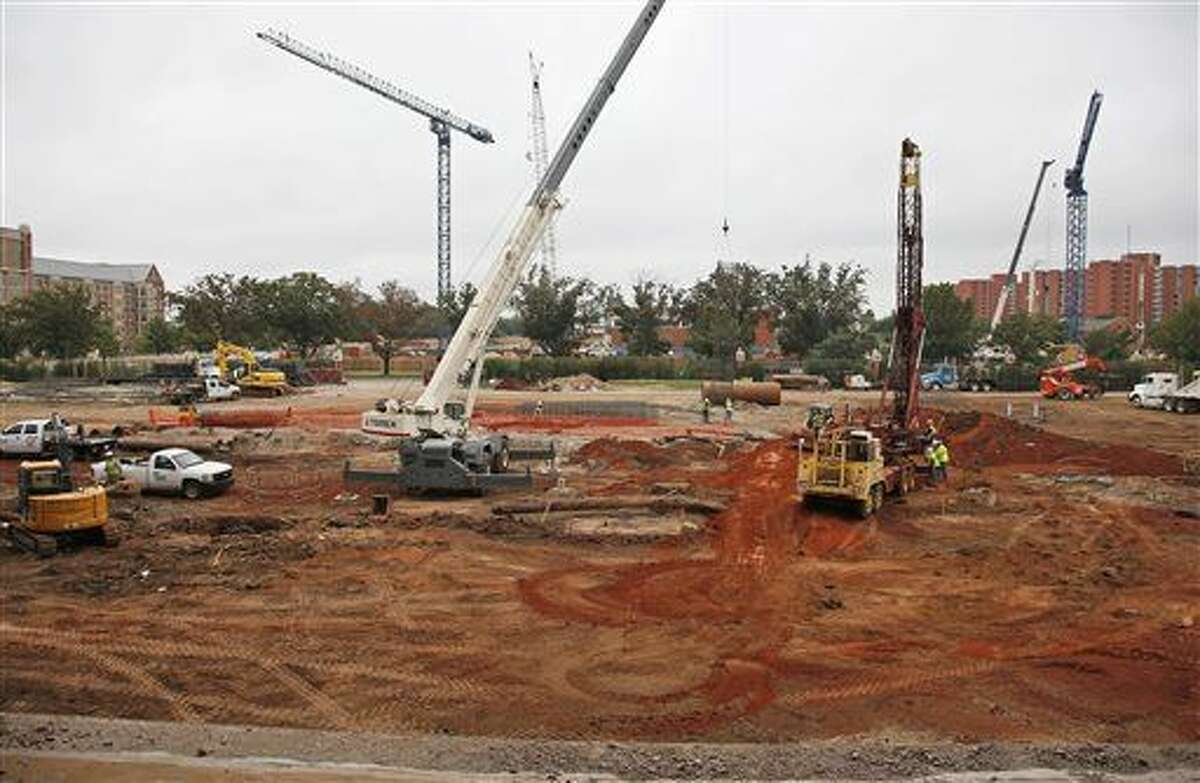 In this Oct. 1, 2015 photo, renovations continue at the University of Oklahoma's football stadium in Norman, Okla. Tumbling crude prices in oil-rich states are pinching off the largesse that helps universities when state budgets are strained. Oklahoma has scaled back a planned $370 million renovation to its football stadium. (AP Photo/Sue Ogrocki)
