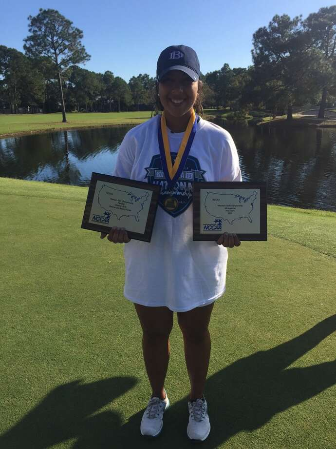Midland Christian grad and Dallas Baptist freshman Christian Curnutte poses with her awards after winning the NCCAA women's medalist title in Panama City Beach, Fla., on Wednesday. Photo: Courtesy Photo