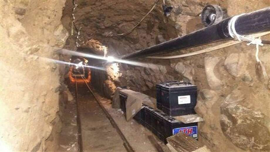 This Wednesday, Oct. 21, 2015 photo released by Mexico's Federal Police shows an underground tunnel that police say was built to smuggle drugs from Tijuana, Mexico to San Diego in the United States. Mexican federal police said the tunnel extends about 2,600 feet (800 meters) and is lit, ventilated, equipped with a rail car system, and lined with metal beams to prevent collapse. (Mexico Federal Police via AP) Photo: HOGP