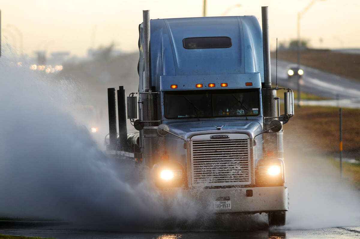 A semi truck drives through standing water on the south exit road near the intersection of Hwy 191 and Loop 250 on Wednesday. James Durbin/Reporter-Telegram