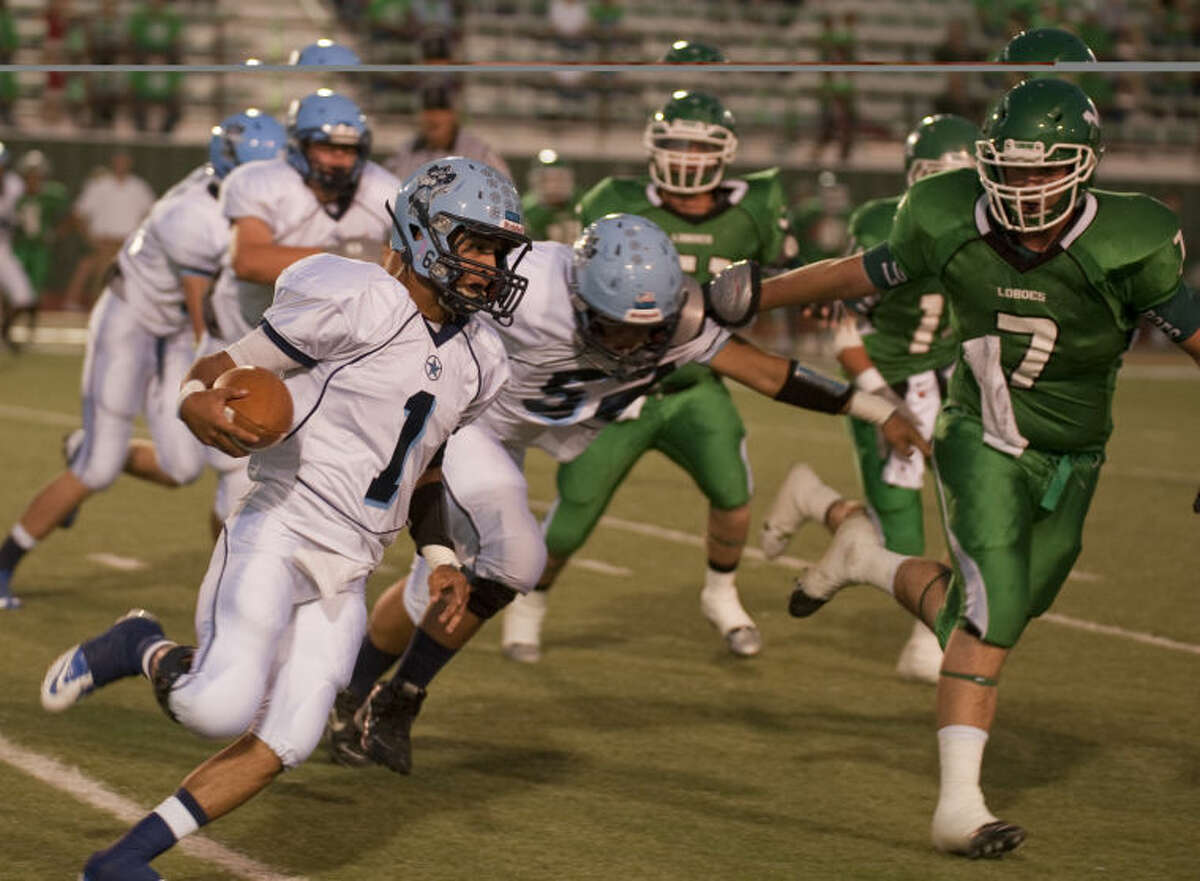 Greenwood's Anthony Salas looks to run outside as Monahans defenders chase Friday evening in Monahans. Tim Fischer\Reporter-Telegram