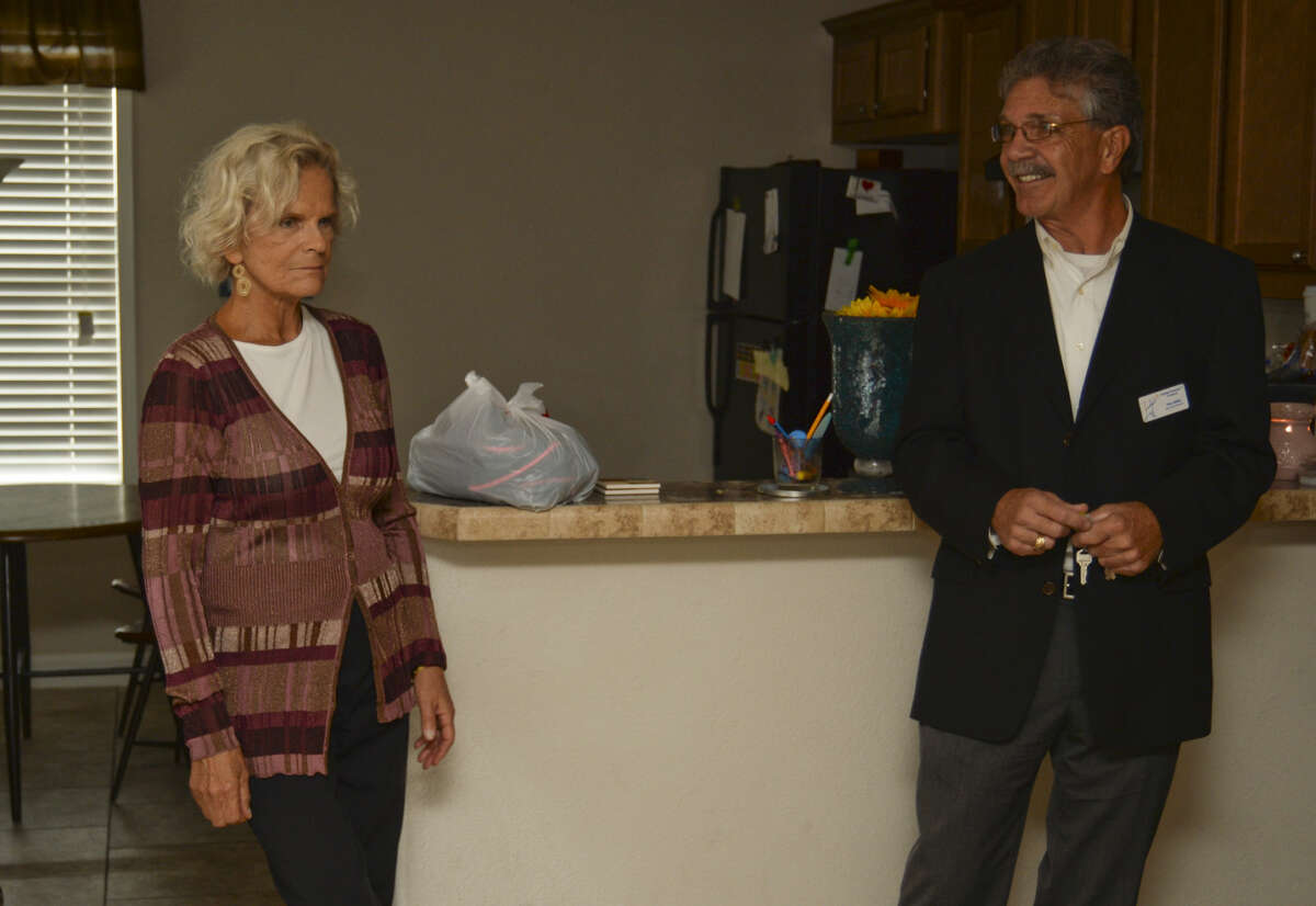 Karen Olsen, founder of Family Promise, gets a tour of one of the resedences by Tom Miller, executive director Wednesday 10-21-2015. Tim Fischer\Reporter-Telegram