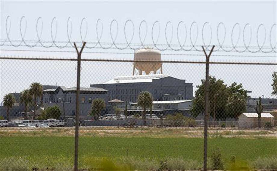 FILE - In this July 23, 2014, file photo, a fence surrounds the state prison in Florence, Ariz., where the execution of Joseph Rudolph Wood took place. Arizona has joined a number of states that have tried to illegally import a lethal injection drug that's not approved in the U.S., according to documents obtained by The Associated Press. The documents revealing Arizona's attempt are part of a lawsuit against the Arizona Department of Corrections over transparency in executions, and the AP is a party in the suit. Executions in the state have been placed on hold following the nearly two-hour death of murderer Joseph Rudolph Wood in 2014. (AP Photo/File) Photo: STF