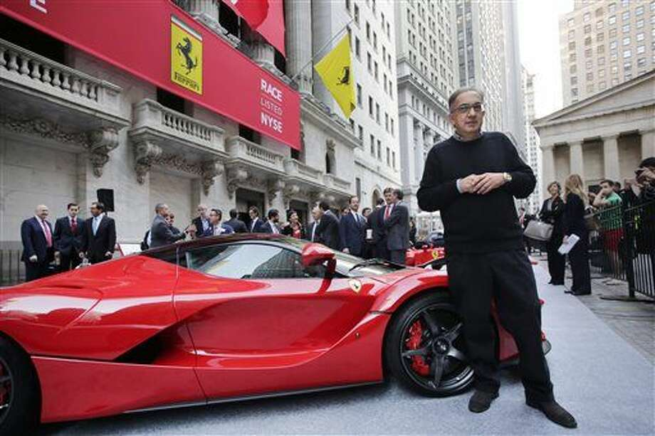 Fiat Chrysler CEO Sergio Marchionne stands with a La Ferrari in front of the New York Stock Exchange prior to Ferrari's IPO, Wednesday, Oct. 21, 2015. Ferrari roared onto the New York Stock Exchange and its shares, trading under the ticker symbol RACE, jumped sharply Wednesday in their public debut. (AP Photo/Mark Lennihan) Photo: Mark Lennihan