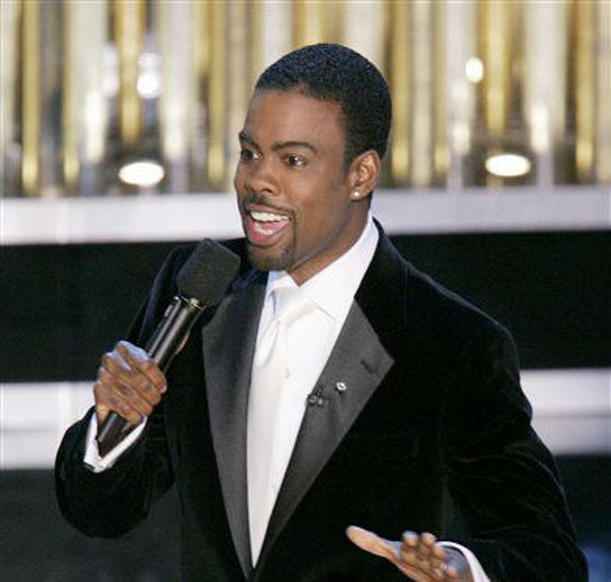 FILE - In this Feb. 27, 2005 file photo, Chris Rock hosts the 77th Academy Awards telecast in Los Angeles. Rock will return to host the Oscars for a second time. The show's producers say the prolific comedian-filmmaker will be at the helm for the 88th Academy Awards next February 28. (AP Photo/Mark J. Terrill, File)
