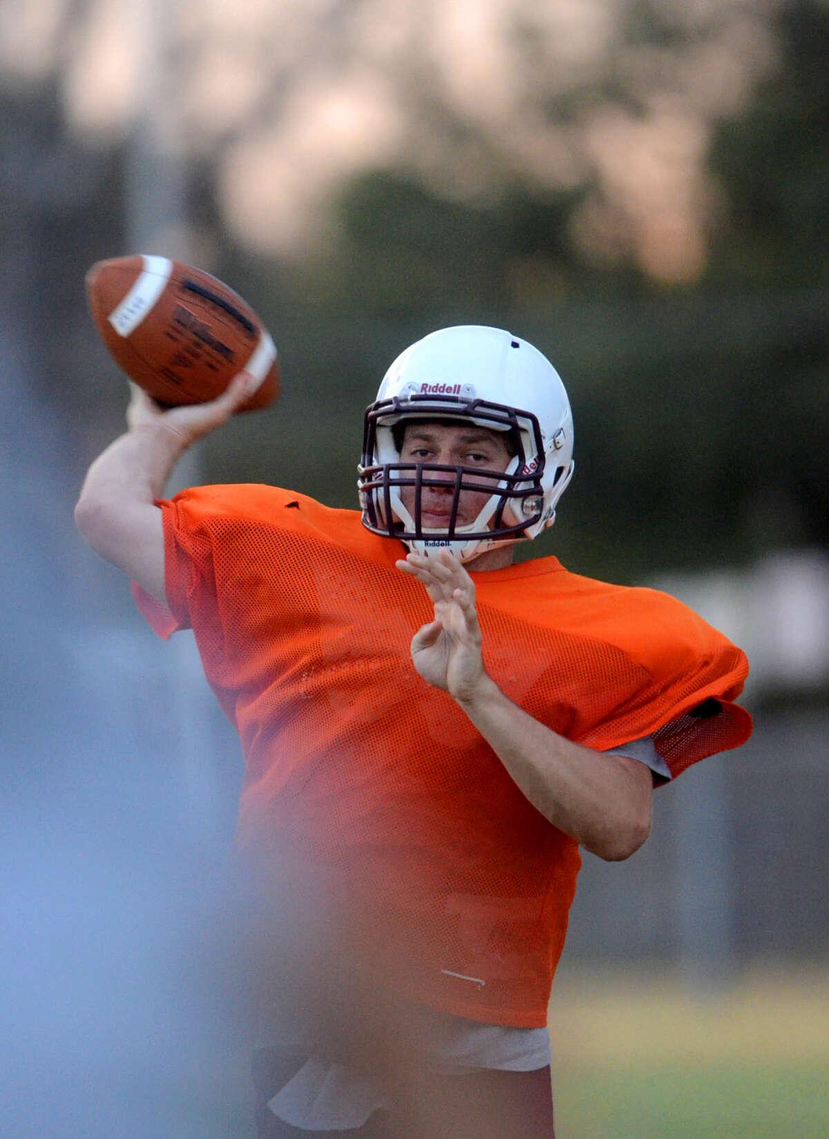 Lee High quarterback Jon Schwalbach makes a pass during practice. James Durbin/Reporter-Telegram