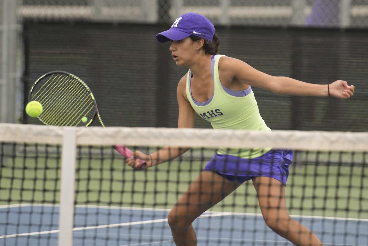 Hannah Rey returns a shot as she and doubles partner Anna Parkison play Wednesday 10-21-2015 in their match at Bush Tennis Center. Tim Fischer\Reporter-Telegram
