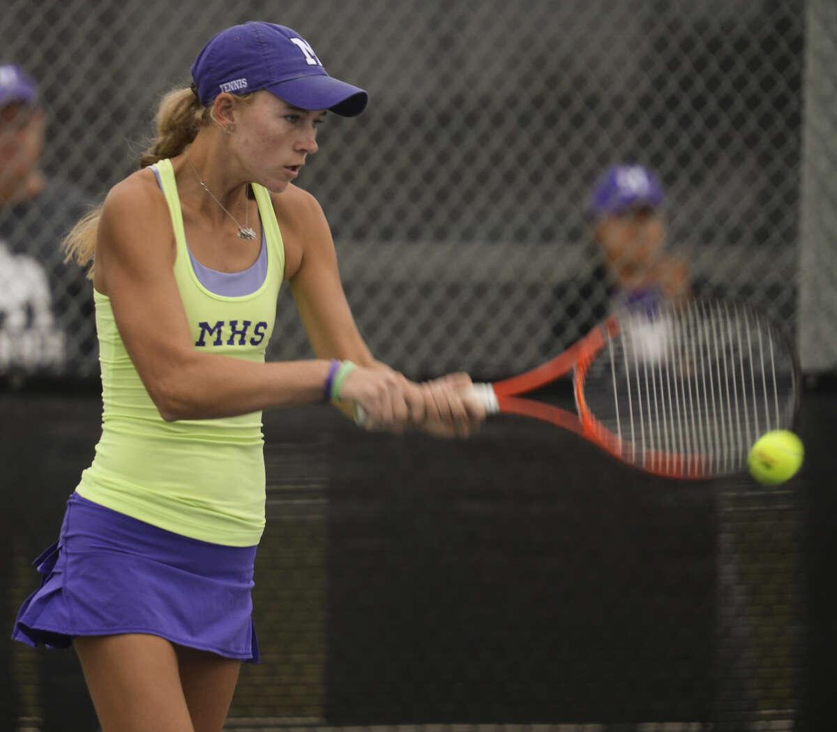 Kate Daugherty returns a shot Wednesday 10-21-2015 in her singles match at Bush Tennis Center. Tim Fischer\Reporter-Telegram