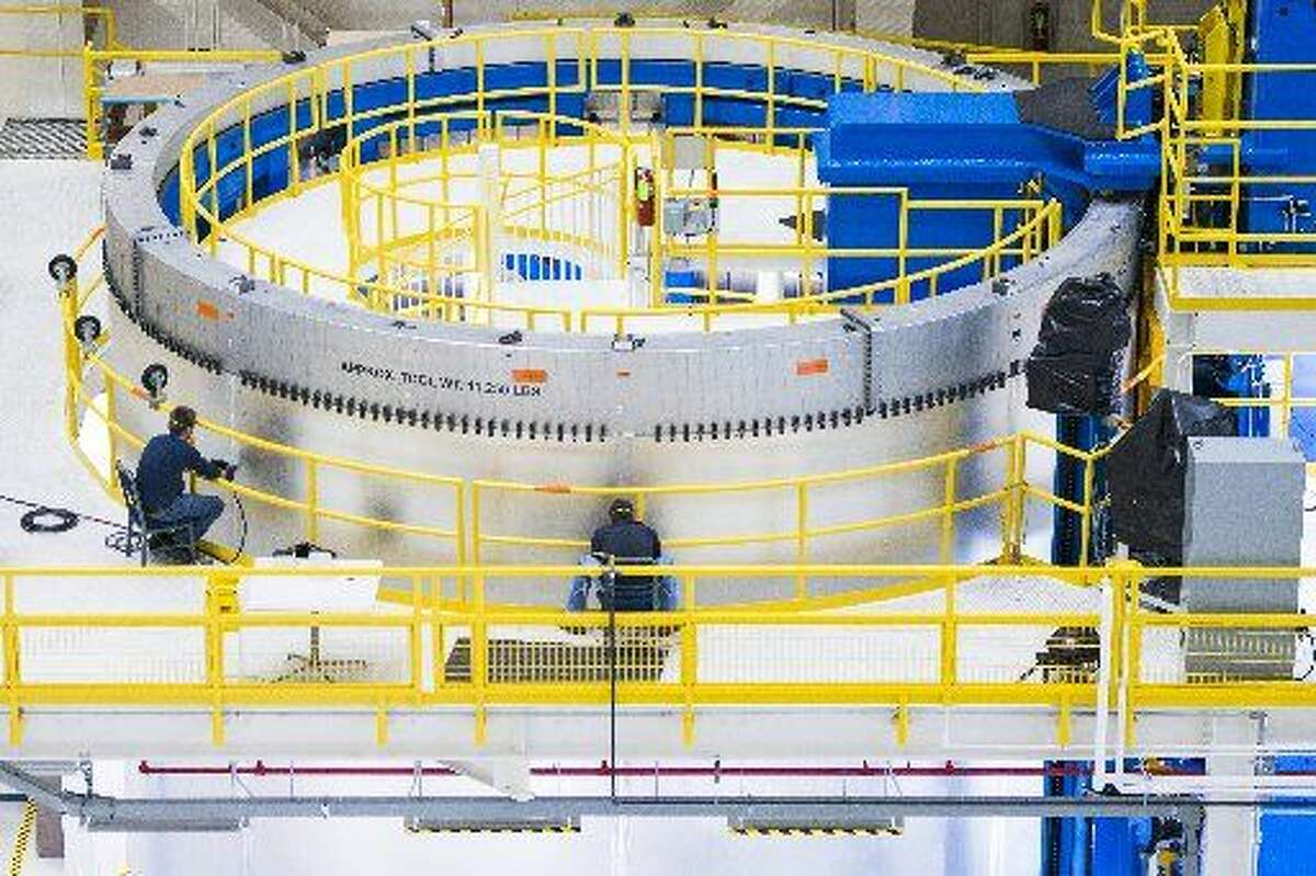 Engineers at NASA's Michoud Assembly Facility work on barrel section of the SLS core stage on March 24 in New Orleans.