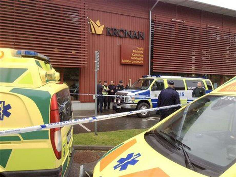 Emergency services attend the scene after a masked man attacked people with a sword, at the Kronan school in Trollhattan, near Goteborg, Sweden, Thursday Oct. 22, 2015. At least six people were injured, and the offender was shot by the police. (Stig Hedstrom / TT via AP) SWEDEN OUT Photo: Stig Hedstrom