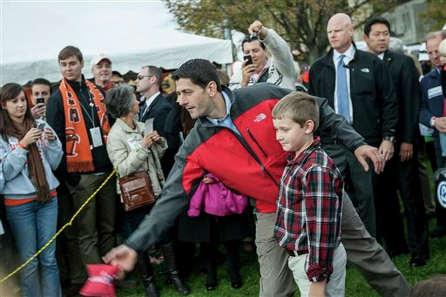 Republican vice presidential candidate, Rep. Paul Ryan, R-Wis., makes a throw in a game, before a football game at Doyt Perry Stadium in Bowling Green, Ohio. (AP Photo/Sentinel-Tribune, Enoch Wu) MANDATORY CREDIT, TOLEDO BLADE OUT Photo: Enoch Wu / Sentinel-Tribune