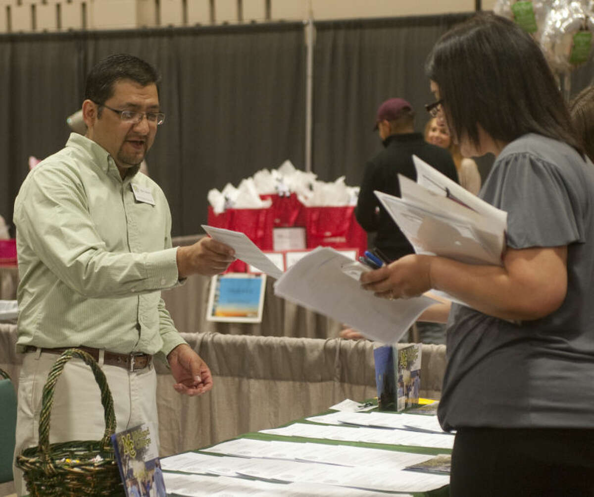 Augustin Gonzales III, with MC human resources, talks with Christina Gonzales Wednesday at the MRT Career Fair at Midland Center. Tim Fischer\Reporter-Telegram