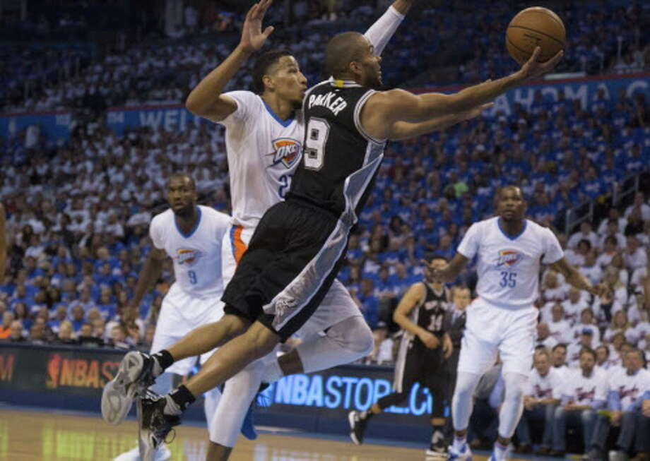 OKLAHOMA CITY, OK - MAY 6: Tony Parker #9 of the San Antonio Spurs sails past Andre Roberson #21 of the Oklahoma City Thunder for two points during the first half of Game Three of the Western Conference Semifinals during the 2016 NBA Playoffs at the Chesapeake Energy Arena on May 6, 2016 in Oklahoma City, Oklahoma.   NOTE TO USER: User expressly acknowledges and agrees that, by downloading and or using this photograph, User is consenting to the terms and conditions of the Getty Images License Agreement. (Photo by J Pat Carter/Getty Images) Photo: Getty Images