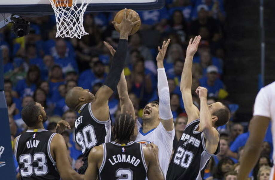 OKLAHOMA CITY, OK - MAY 6:David West #30 and Manu Ginobili #20 of the San Antonio Spurs battle Enes Kanter #11 of the Oklahoma City Thunder for the ball  during the first half of Game Three of the Western Conference Semifinals during the 2016 NBA Playoffs at the Chesapeake Energy Arena on May 6, 2016 in Oklahoma City, Oklahoma.   NOTE TO USER: User expressly acknowledges and agrees that, by downloading and or using this photograph, User is consenting to the terms and conditions of the Getty Images License Agreement. (Photo by J Pat Carter/Getty Images) Photo: Getty Images