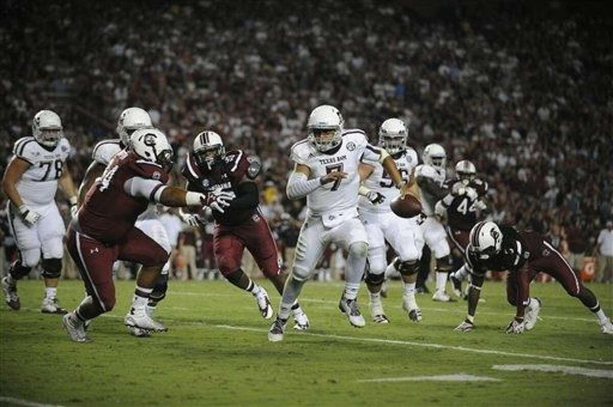 Texas A&M quarterback Kenny Hill (7) runs against South Carolina during the second half of an NCAA college football game on Thursday, Aug. 28, 2014, in Columbia, S.C. Texas A&M won 52-28. (AP Photo/Rainier Ehrhardt)