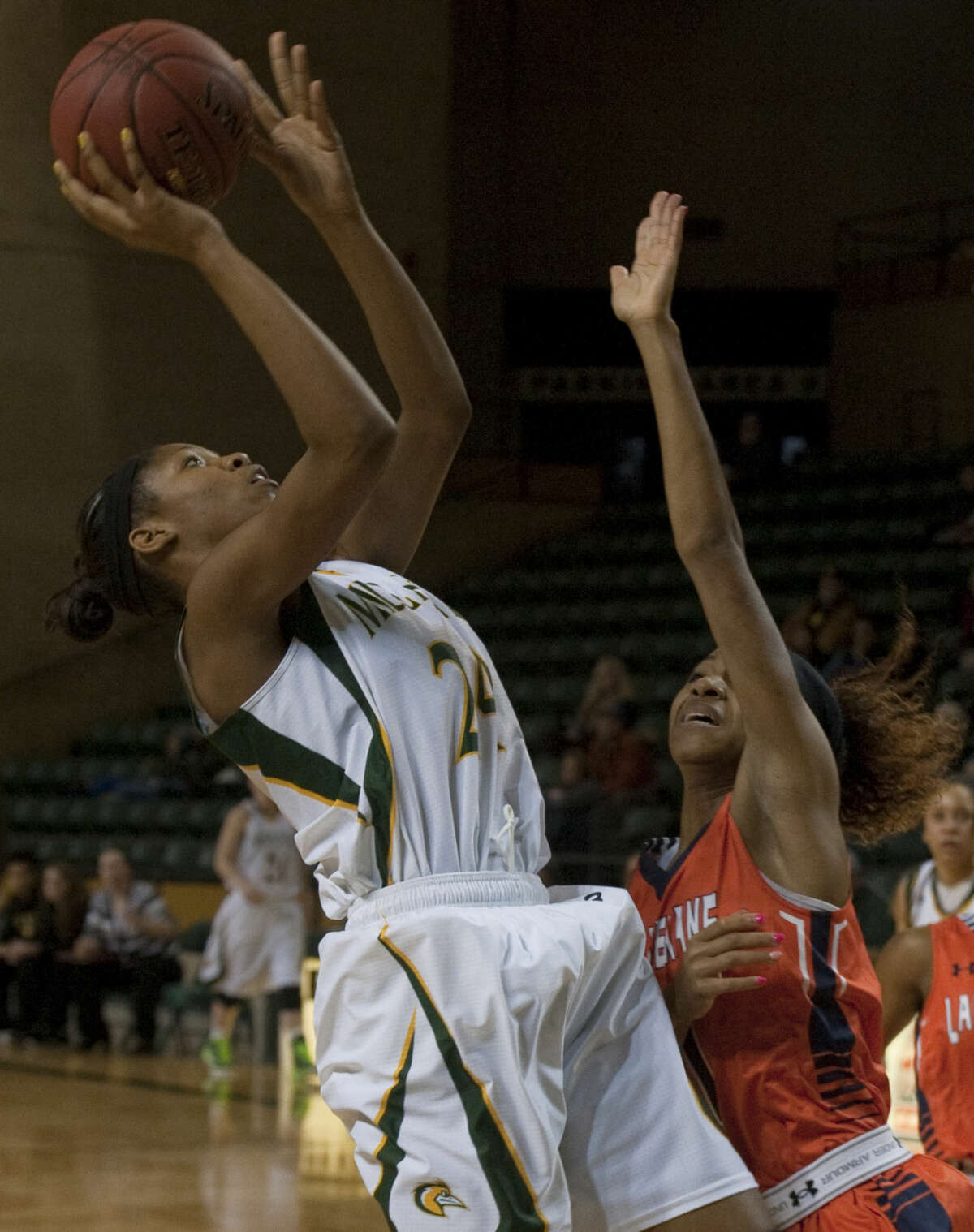 Midland College's Walnatia Wright leans back to get a shot off over South Plains' Blevie Meyia Lucchesi Thursday, 1-22-15, at the Chaparral Center. Tim Fischer\Reporter-Telegram