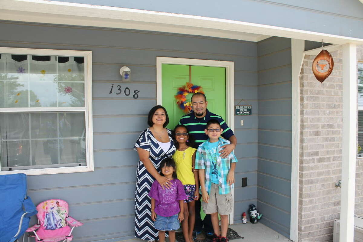 Teressa and Joey Martinez and their children, Madilyn, from left, Meya, and Julian, recently moved in their own home, a project of Midland Habitat for Humanity.
