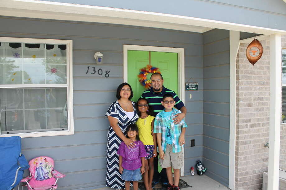 Teressa and Joey Martinez and their children, Madilyn, from left, Meya, and Julian, recently moved in their own home, a project of Midland Habitat for Humanity. Photo:  Steve Kuhlmann/Reporter-Telegram