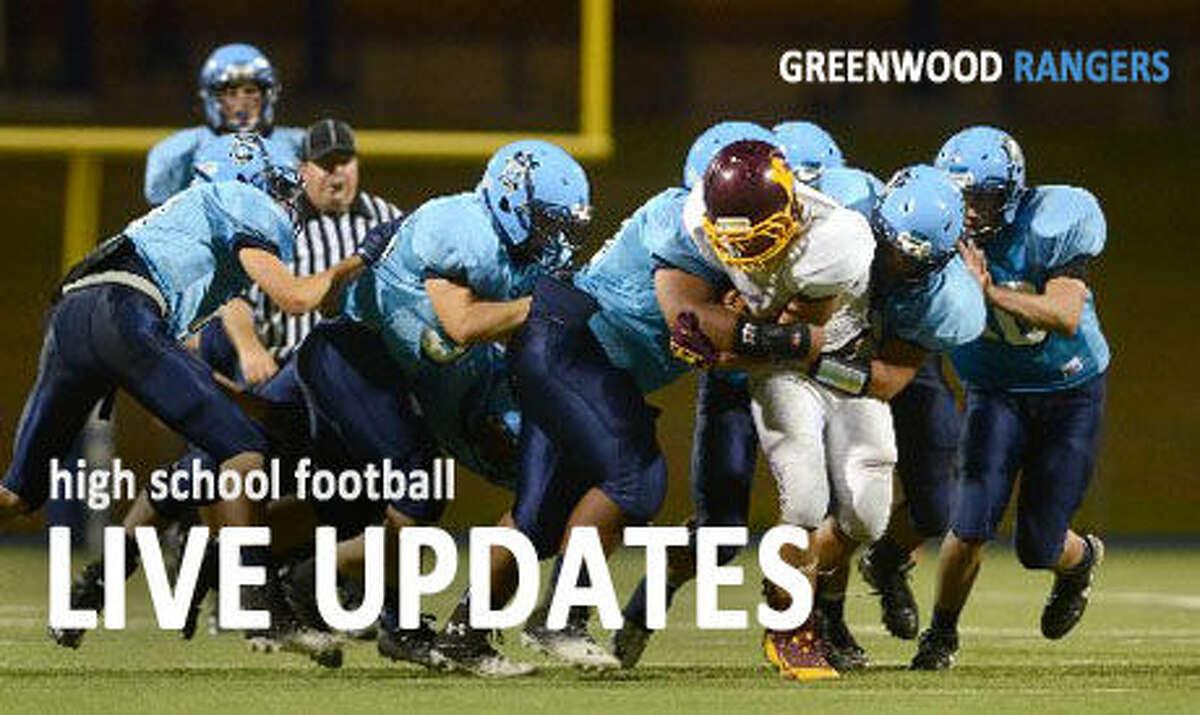 The Greenwood defense wraps up Kermit's Xavier Quiroz Thursday at Grande Communications Stadium.