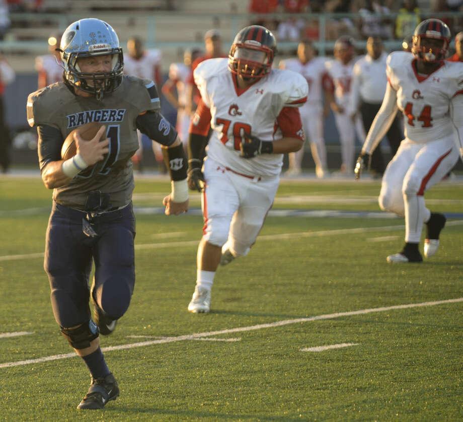 Greenwood running back Stace Bell runs for yards against Brownfield on Friday 9-4-2015. Tim Fischer\Reporter-Telegram Photo: Tim Fischer