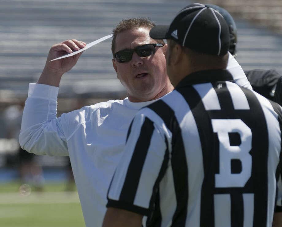 Texas Tech defensive coordinator Matt Wallerstedt talks with an official at the Texas Tech scrimmage at Grande Communications Stadium on March 29. Tim Fischer\Reporter-Telegram Photo: Tim Fischer
