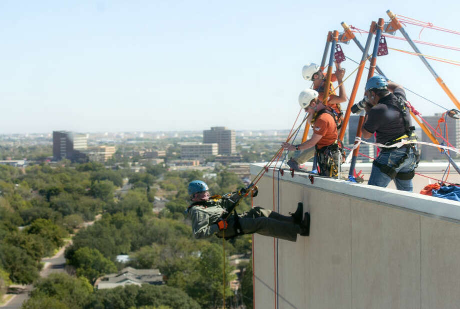 Ed Magruder participates in the Over The Edge for scouting event by rappelling down the side of the Scharbauer tower on Wednesday. James Durbin/Reporter-Telegram Photo: JAMES DURBIN