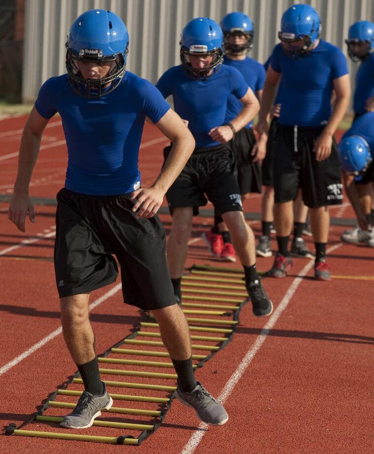 Trinity players run conditioning drills during practice Wednesday morning. Tim Fischer\Reporter-Telegram Photo: Tim Fischer