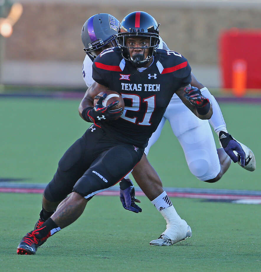 Texas Tech running back DeAndre Washington (21) runs through a huge hole in Saturday night action against the University of Central Arkansas. Photo: Wade H Clay