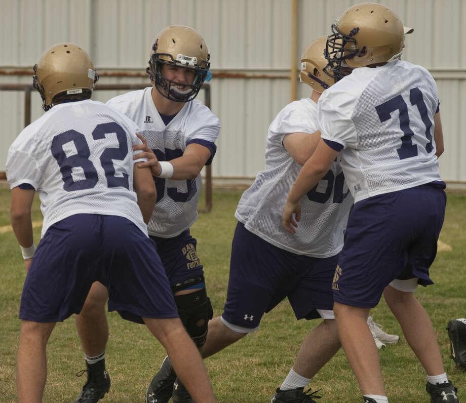 Midland High players run drills Monday morning during the first day of practice. Tim Fischer\Reporter-Telegram Photo: Tim Fischer