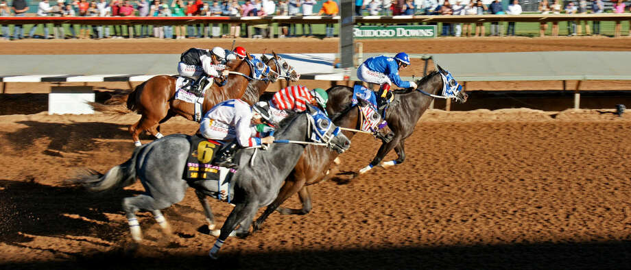 Jm Miracle leads the field to the finish line during the All American Futurity on Monday at Ruidoso Downs. Photo courtesy of Gay Harris/Ruidoso Downs