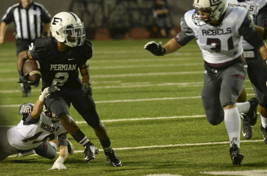 Permian's Kobe Robinson tries to get away from Lee High's Tristan Martinez as Ryan Dean comes in to help stop him Friday 10-9-2015 at Ratliff Stadium. Tim Fischer\Reporter-Telegram Photo: Tim Fischer