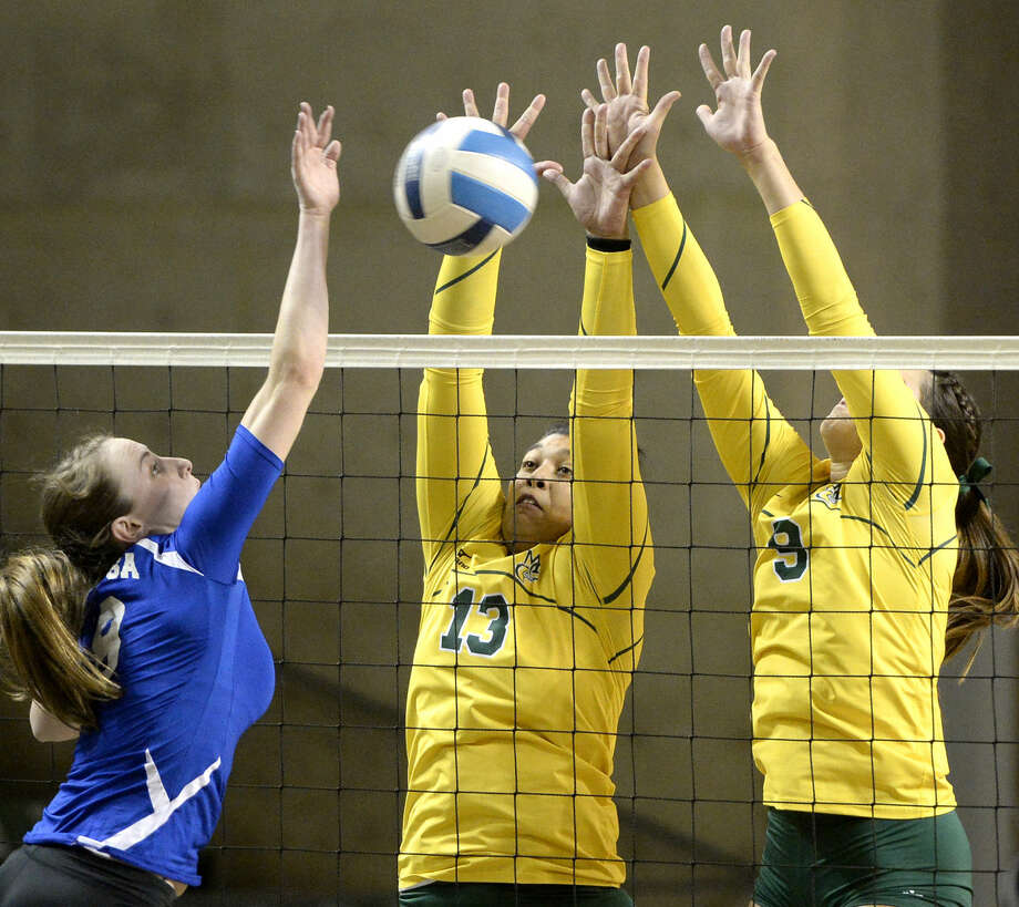 Midland College's Larissa Gomes (13) and Shelby Bartley (9) block a hit from Odessa College's Lauren Zoller (8) on Wednesday, Oct. 28, 2015, at Chaparral Center. James Durbin/Reporter-Telegram Photo: James Durbin