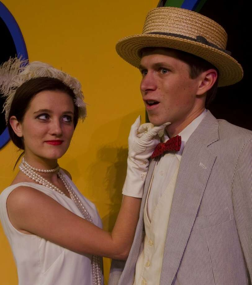"Darian Butler, as Reno, flirts with a shy Stone Fuglaar, as Sir Evelyn, in Pickwick Players' production of ""Anything Goes."" Photo by Tim Fischer/Reporter-Telegram Photo: Tim Fischer"