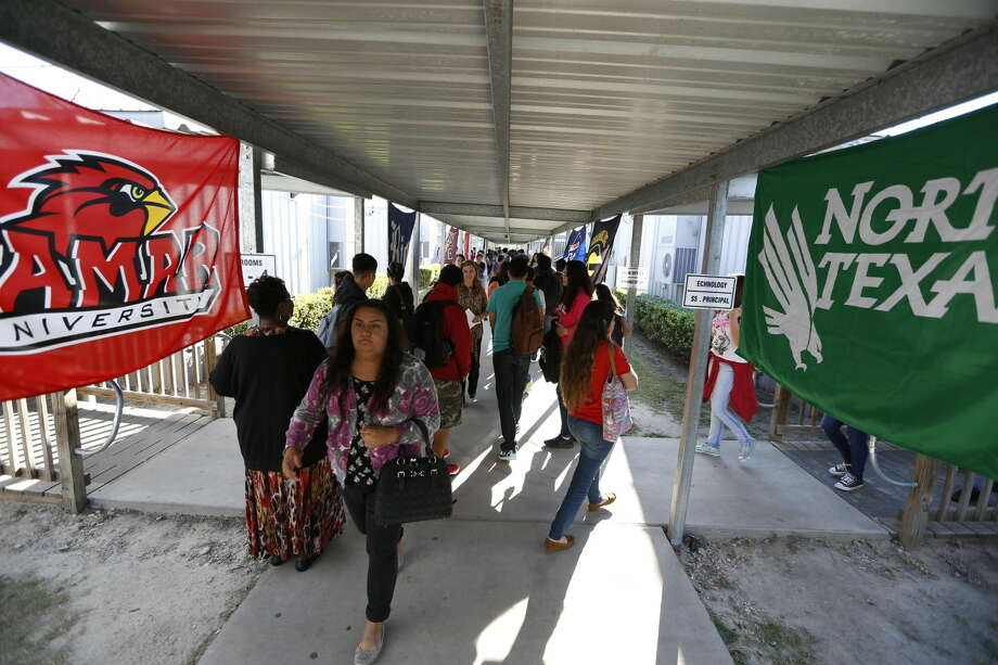 North Houston Early College High School, 99 Lyerly Street, walk past flags of Colleges and Universities between classes Monday, Oct. 5, 2015, in Houston. ( Steve Gonzales / Houston Chronicle ) Photo: Steve Gonzales