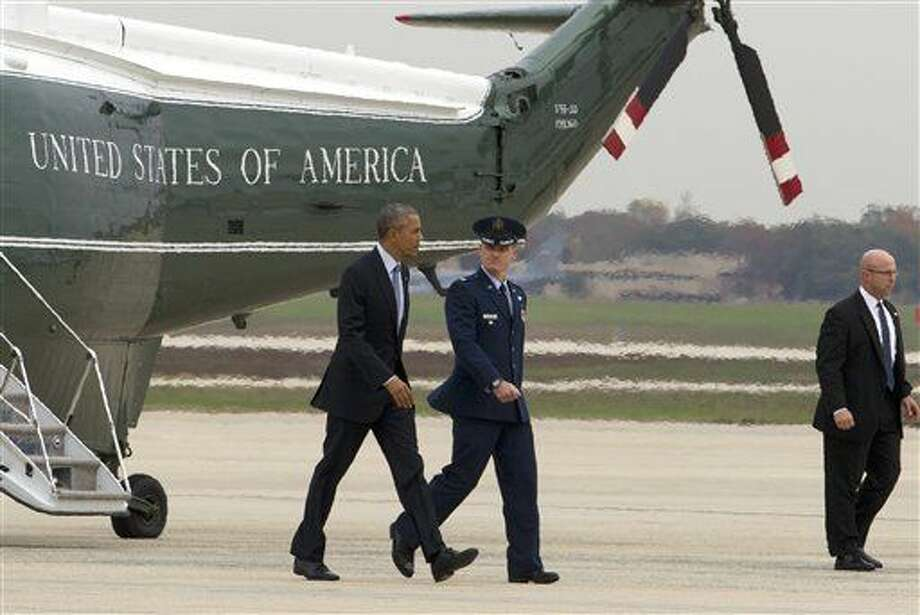 President Barack Obama, accompanied by Vice Commander, of the 89th Airlift Wing Colonel Christopher M. Thompson, walks towards Air Force One before is departure from Andrews Air Force Base, Md., Tuesday, Oct. 27, 2015. Obama is traveling to Chicago to speak at the International Association of Chief of Police conference and attend democratic fundraisers. ( AP Photo/Jose Luis Magana) Photo: Jose Luis Magana