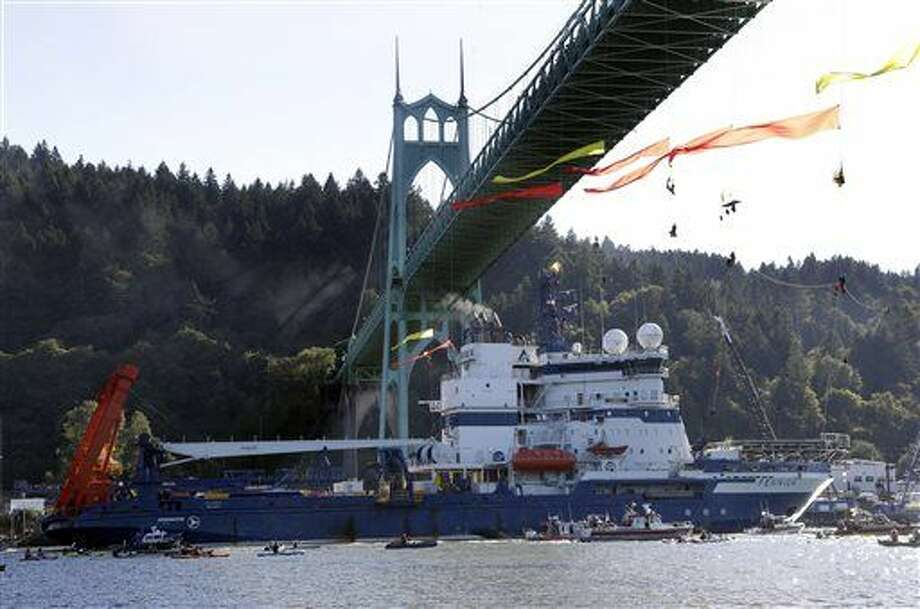 File - In this July 30, 2015 file photo, the Royal Dutch Shell PLC icebreaker Fennica heads up the Willamette River under protesters hanging from the St. Johns Bridge on its way to Alaska in Portland, Ore. Royal Dutch Shell will cease exploration in Arctic waters off Alaska's coast following disappointing results from an exploratory well backed by billions in investment and years of work. The announcement that came on Monday, Sept. 28, was a huge blow to Shell, which was counting on offshore drilling in Alaska to help it drive future revenue. Environmentalists, however, had tried repeatedly to block the project and welcomed the news. (AP Photo/Don Ryan, File) Photo: Don Ryan