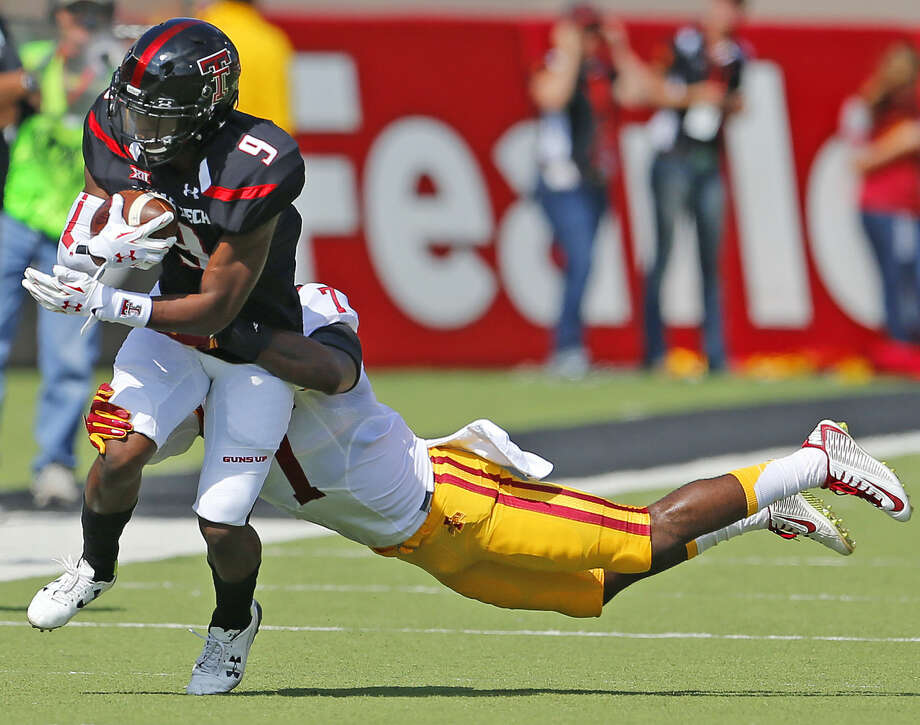 Texas Tech receiver Jonathon Giles (9) drags an Iowa State defender for positive yards in Big 12 action. Photo: Wade H Clay